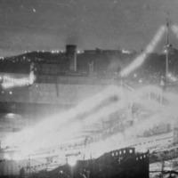 Праздник в бригаде.Флаги расцвечивания и огни говорят о то, что это значимый день.Фото с плавбазы «Север», вечером или ночью
