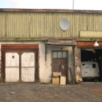 Омчак. Это был хозяйственный магазин.Теперь - гараж скорой помощи.. Автор фото: Евгения Ильенкова